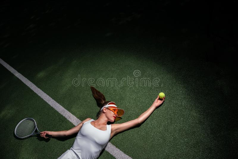 Young attractive girl playing tennis stock image