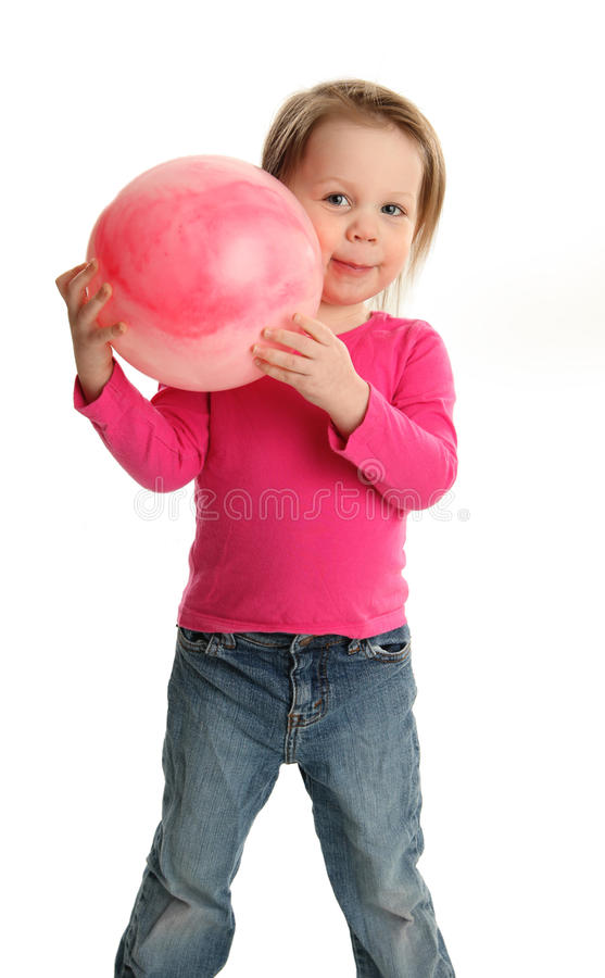 Young girl playing with a toy ball stock photos