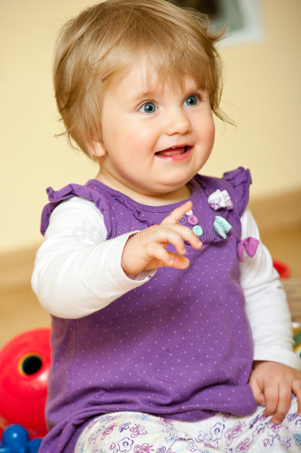 Young girl pointing stock images