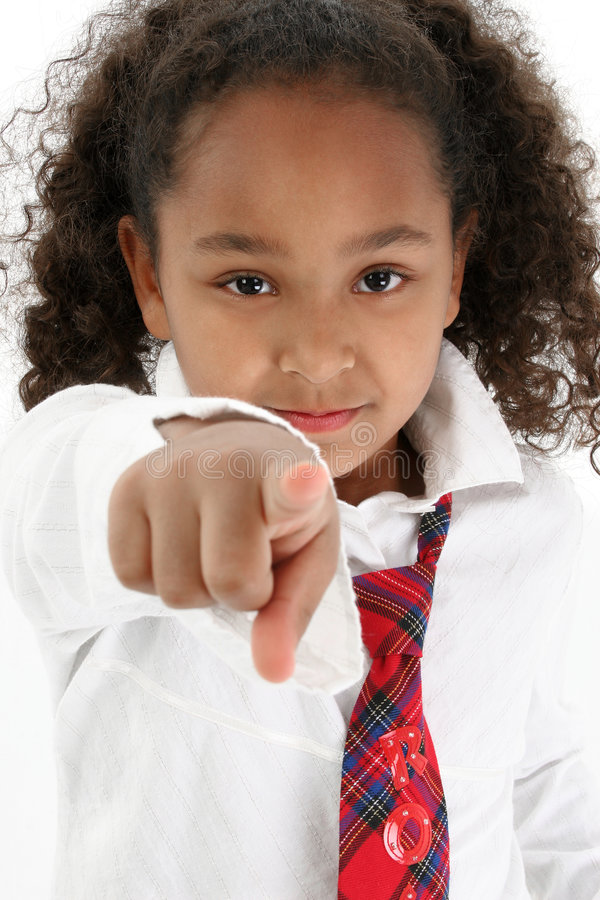 Young girl pointing finger. Young girl wearing a white shirt and tie pointing finger at the viewer royalty free stock photography