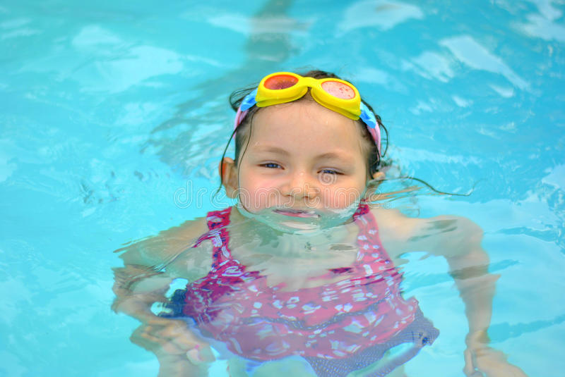 Download Young girl in the pool stock photo. Image of tropic, family - 27159206