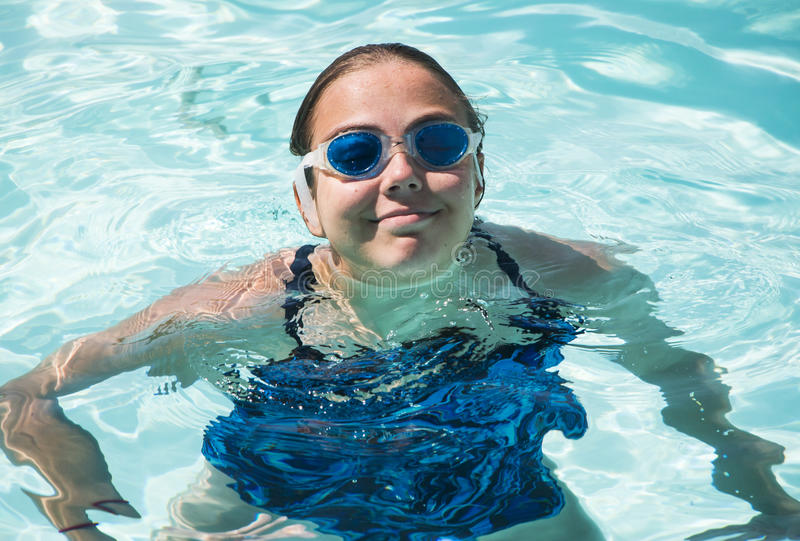 Young girl in pool. Cute Young girl in pool with goggles stock images