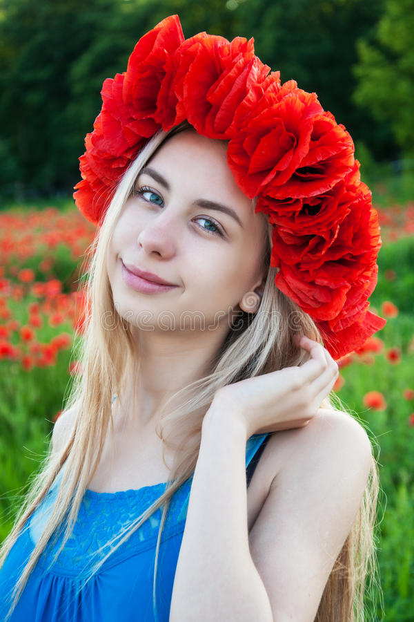 Young girl in the poppy field royalty free stock photos