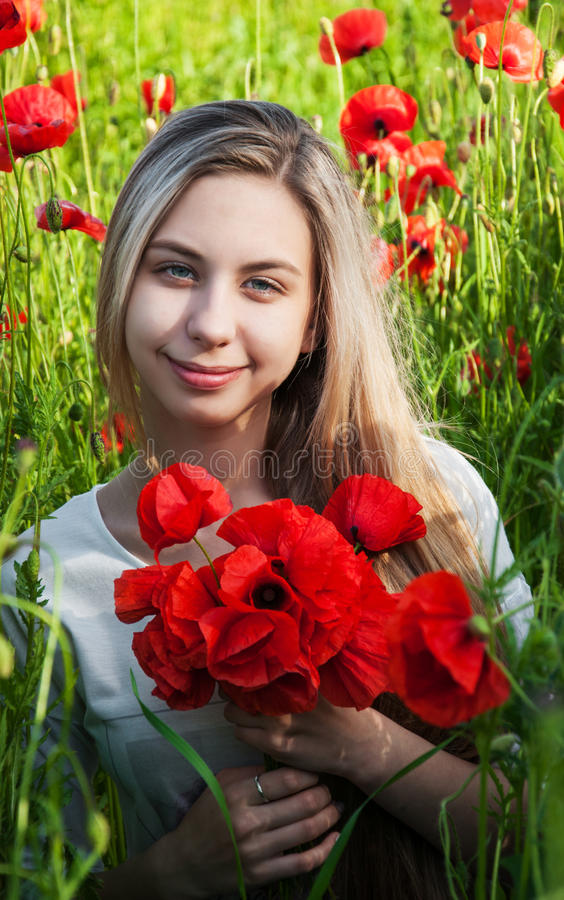 Young girl in the poppy field royalty free stock photo