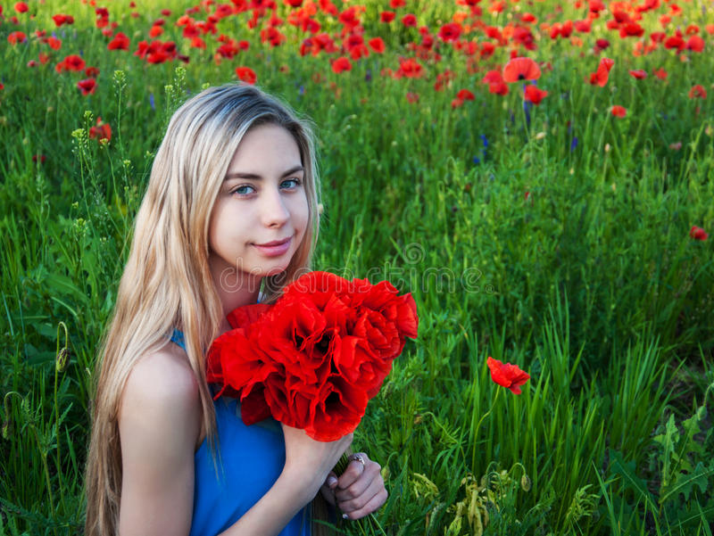 Young girl in the poppy field. Beautiful young girl in the poppy field stock images