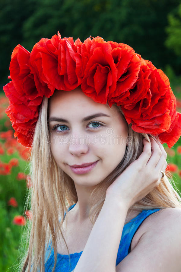 Young girl in the poppy field. Beautiful young girl in the poppy field royalty free stock photography