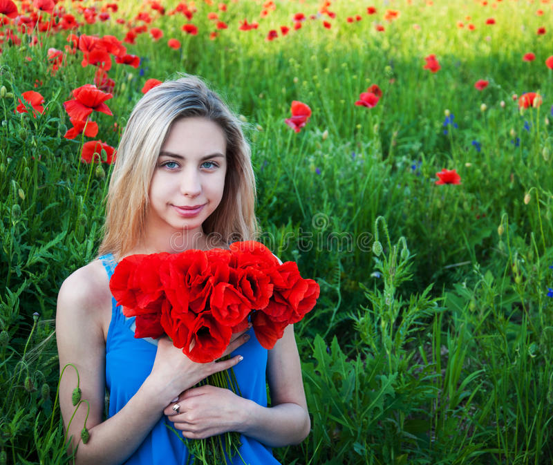 Young girl in the poppy field. Beautiful young girl in the poppy field stock photos
