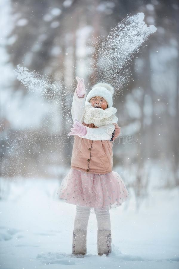 Young girl portrait have fun with snow in winter park stock photography