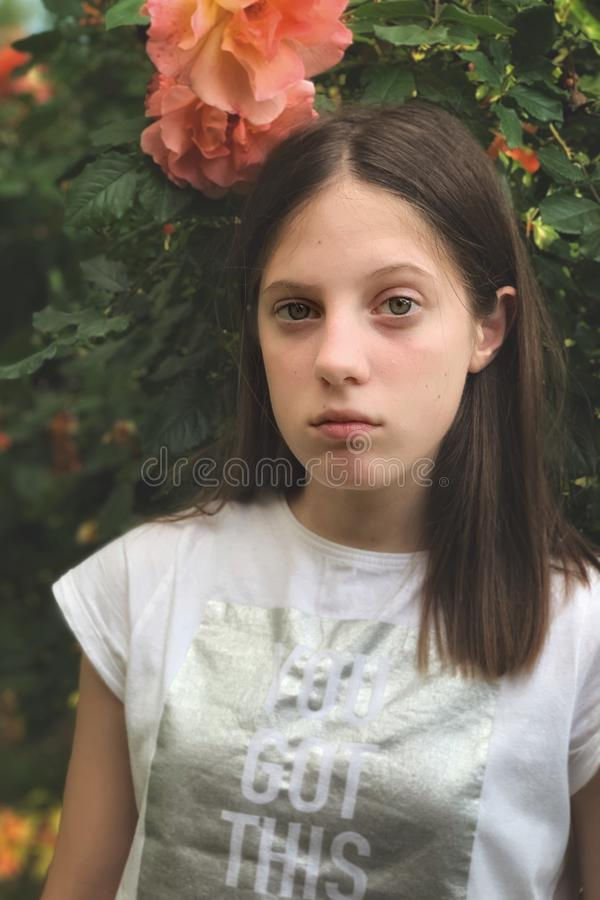 Young girl in the rose garden portrait royalty free stock images