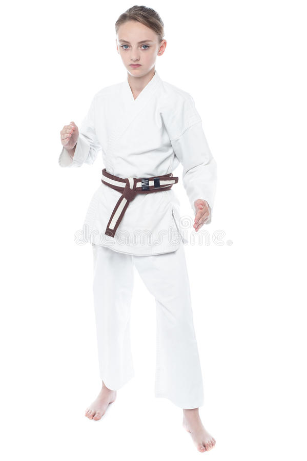 Young girl practicing karate royalty free stock image