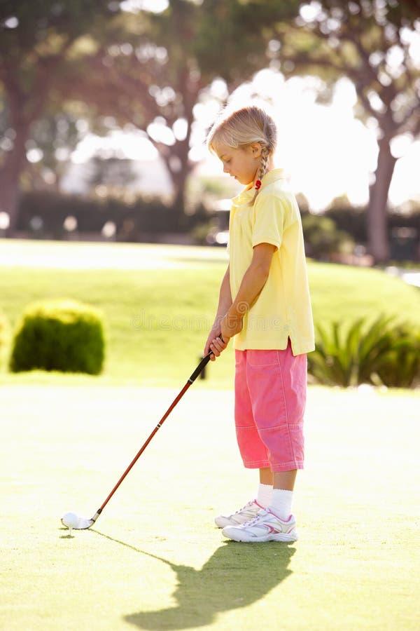 Young Girl Practising Golf Stock Image