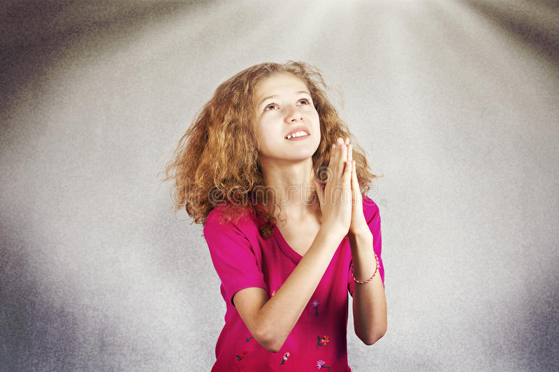 Young girl praying stock photos
