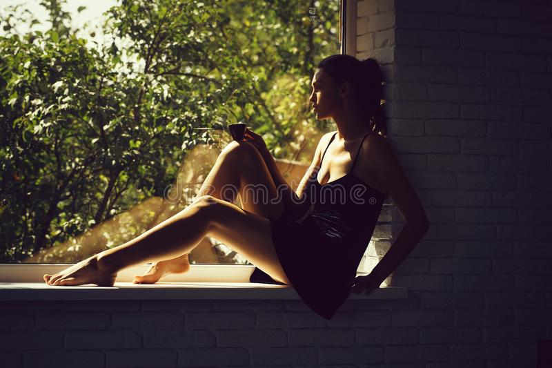 Pretty girl on window sill royalty free stock image