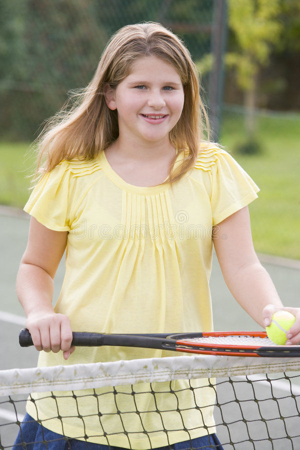 Download Young Girl With Racket On Tennis Court Smiling Royalty Free Stock Photo - Image: 5944155