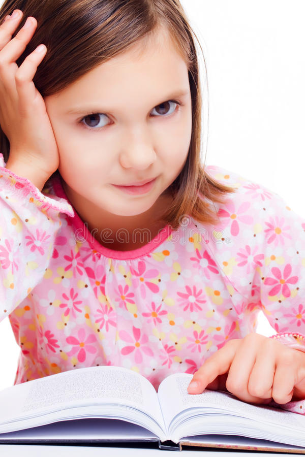 Young girl reading a book stock images