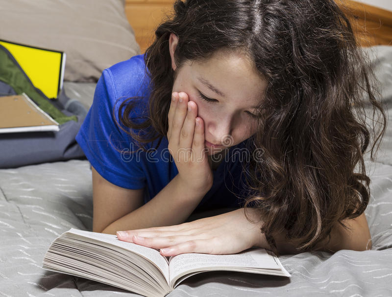 Download Young Girl Reading Book In Bedroom Royalty Free Stock Photos - Image: 26532558