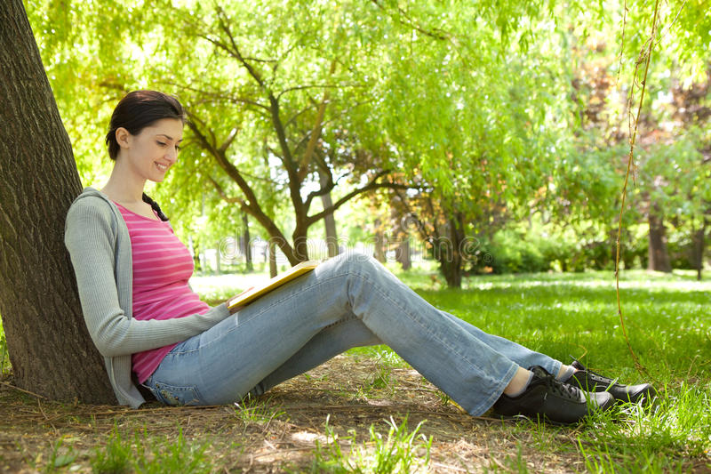 Download Young Girl Reading Book In Nature Stock Image - Image of caucasian, park: 19693315