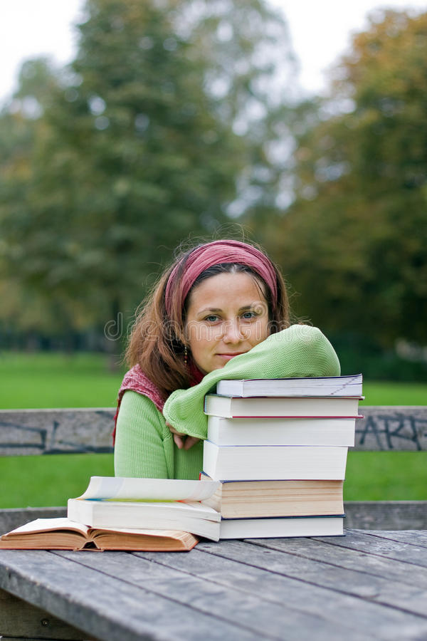 Download Young Girl Reading A Book In A Park Stock Image - Image: 16437867