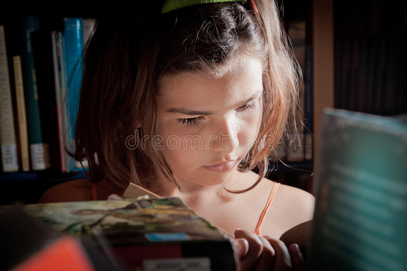 Download Young Girl Reading In A Library Stock Photo - Image: 20307992