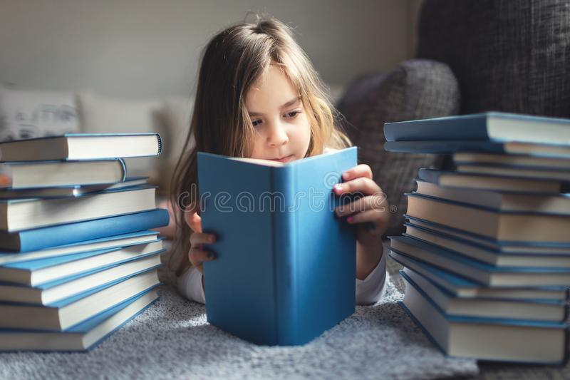 Young girl reads the book. stock photo