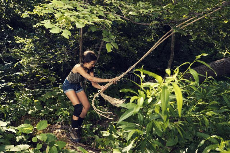 Young girl ready for jump in a forest Summer time royalty free stock image