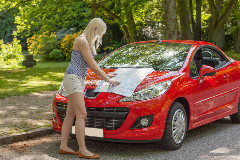Download A Young Girl With A Red Car Stock Image - Image: 24979235