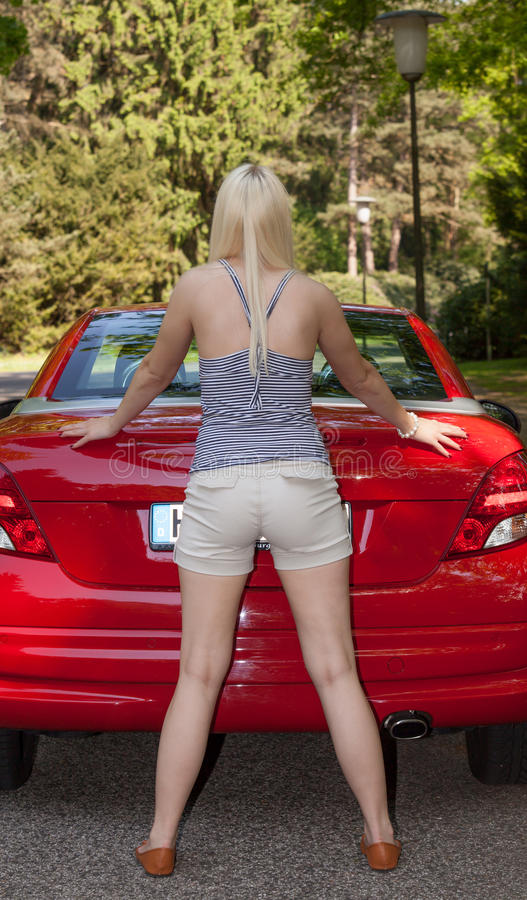 Download A Young Girl With A Red Car Stock Image - Image: 25005979