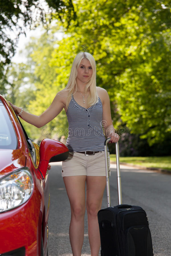 Download A Young Girl With A Red Car Stock Photo - Image: 25006178