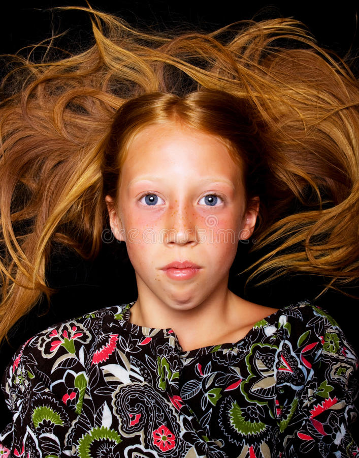 Young girl with red hair royalty free stock photography