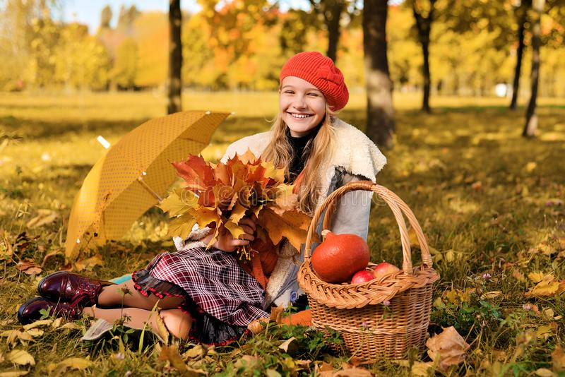 Young girl in red hat happy smiling stock photo