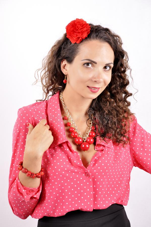 Young girl with a red necklace, bracelet, hairpin on a white background.  royalty free stock photos