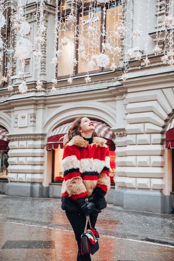 Young russian girl on the red Square through winter holiday in Moscow, stylish and beautiful posing near to Gum. Young girl on the red Square through winter stock photos