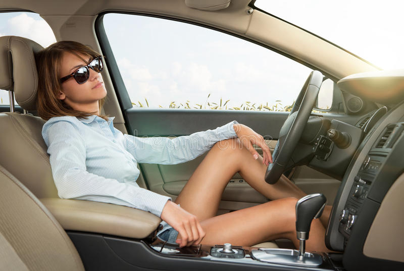 Young girl relaxing in the car stock photos