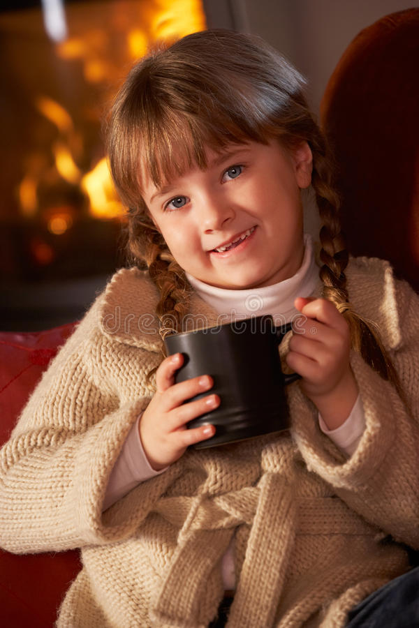 Young Girl Relaxing With Hot Drink royalty free stock image