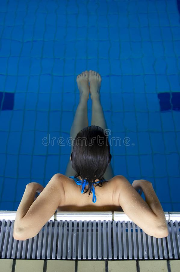 Young girl relaxing in pool 02 royalty free stock images