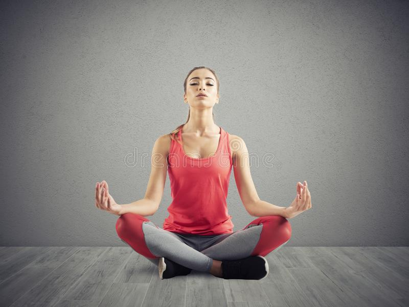 Young girl relaxing in yoga position stock image