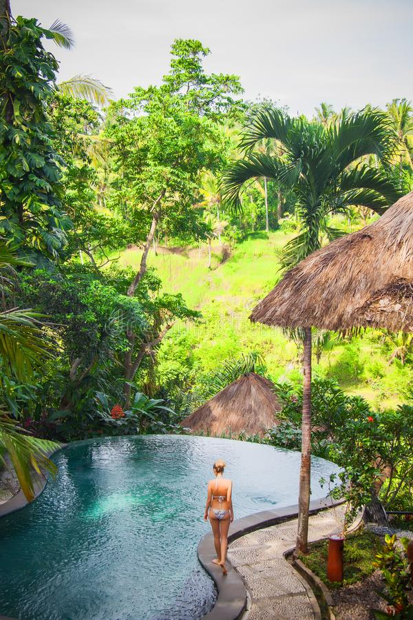 Young girl resting in beautiful island jungle. Lifestyle travelling stock image