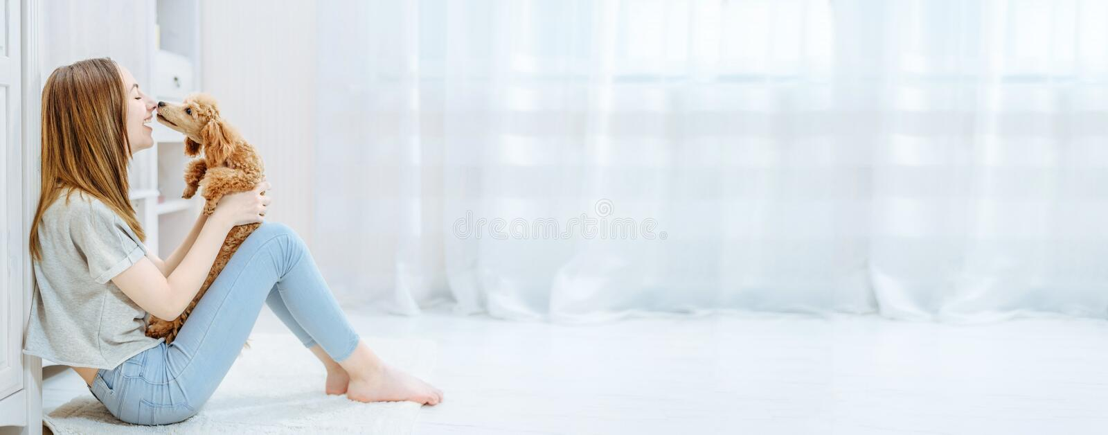 Young girl is resting with a dog on the floor at home . stock images