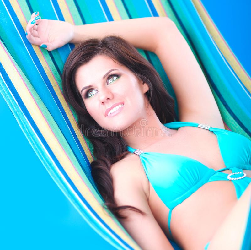 Young girl resting in a hammock in the summer stock photo