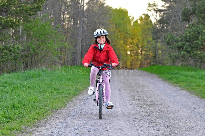 Download Young Girl Riding Bicycle Royalty Free Stock Images - Image: 9422219