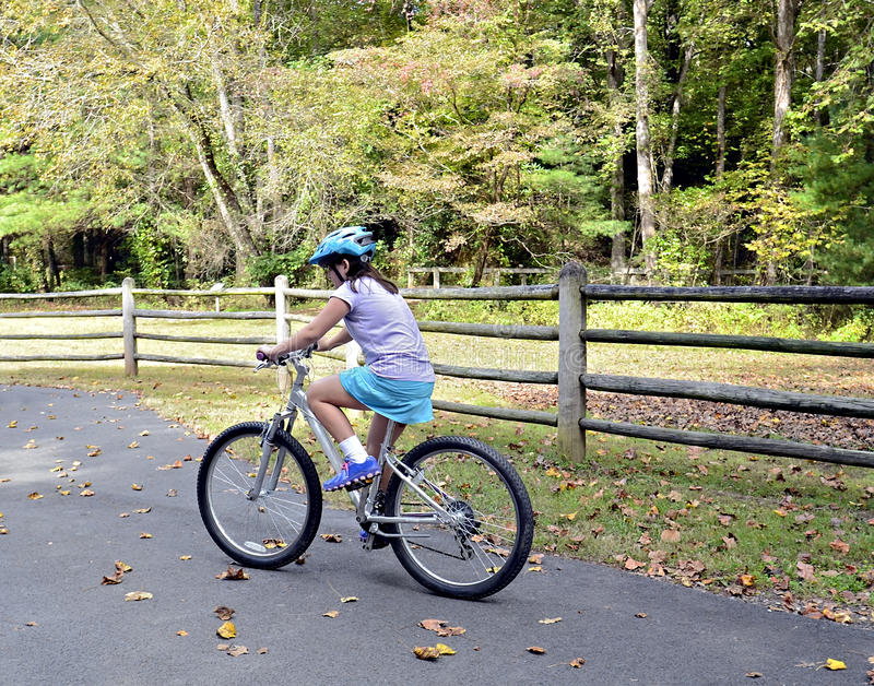 Young Girl Riding Bike stock photography