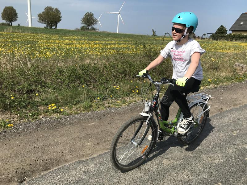 Young girl riding a bike in Polish countryside stock photo