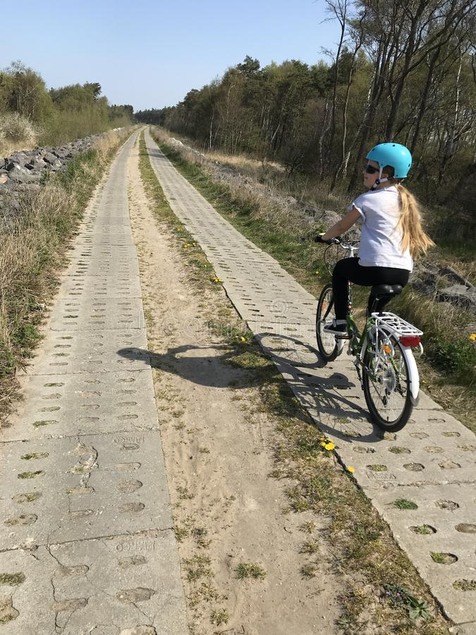 Young girl riding a bike in Polish countryside royalty free stock photo