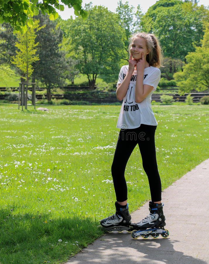 Young girl on roller skates stock image