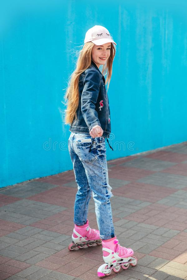 Young girl on rollerblades in the city royalty free stock photography