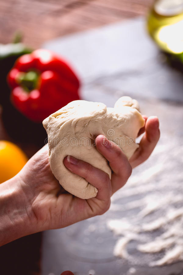 Download Young Girl`s Hand Knead The Dough Stock Photo - Image of cheese, cuisine: 83724424