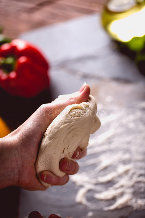 Download Young Girl`s Hand Knead The Dough Stock Photo - Image: 83724434