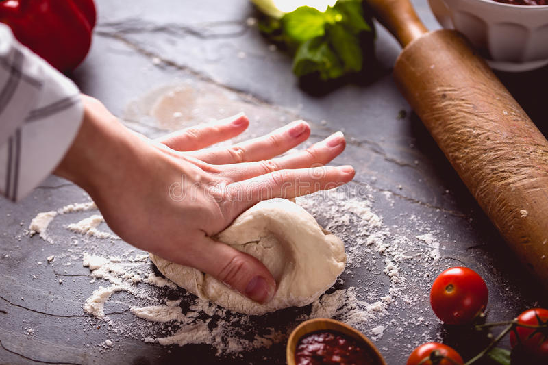 Download Young Girl`s Hand Knead The Dough Stock Photo - Image: 83724519