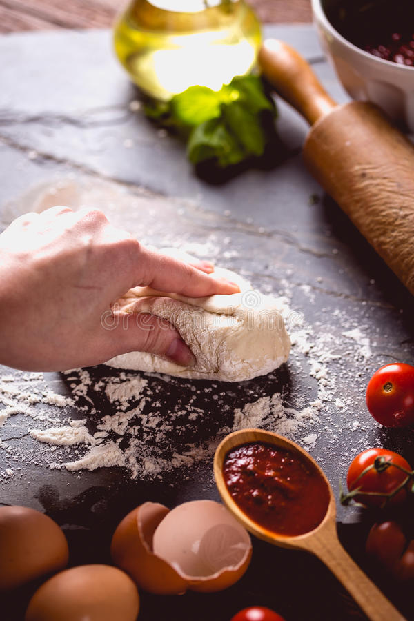 Download Young Girl`s Hand Knead The Dough Stock Photo - Image: 83724558