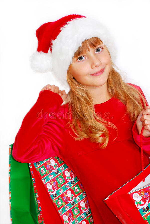 Download Young Girl In Santa Cloth With Gift Bags Stock Image - Image: 11245273